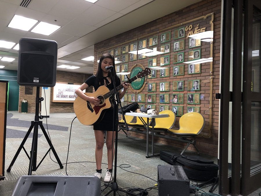 SING, SING, SING. Senior Yvanna Reyes sings a song while playing the guitar at the Senior Art Show on May 4. Senior Keren Idelman-Sidenko played a piano accompaniment. Though the art show was officially from 5:00 to 7:00 p.m., the art pieces will continue to be on display during the week.