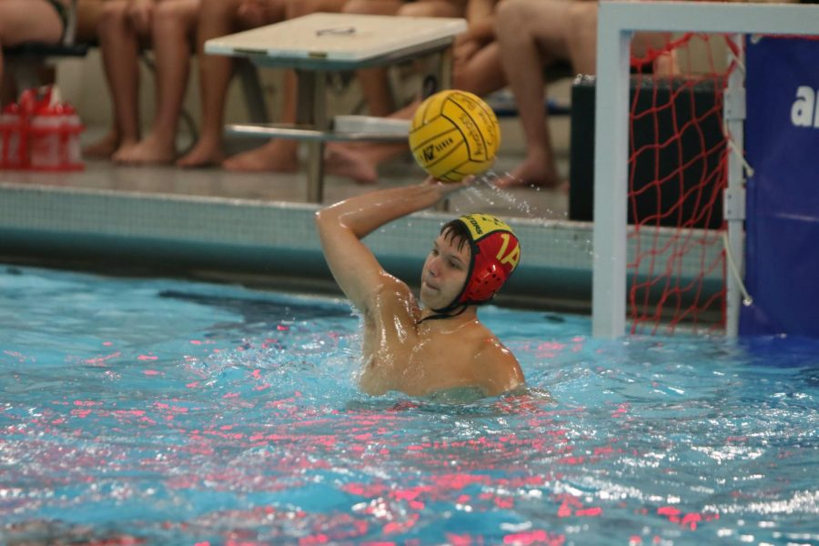 SAVE.+Freshman+Christopher+Gall+is+one+of+the+goalies+for+JV+water+polo+this+year.+During+the+game%2C+there+are+seven+players+in+the+pool%2C+one+being+the+goalie.+It+is+the+goalies+job+to+block+and+stay+alert+to+any+incoming+balls.+%E2%80%9CI+play+water+polo+because+I+get+to+swim+and+we+have+a+lot+of+fun%2C%E2%80%9D+Gall+said.+All+photos+courtesy+of+McDaniel%27s+Photography.