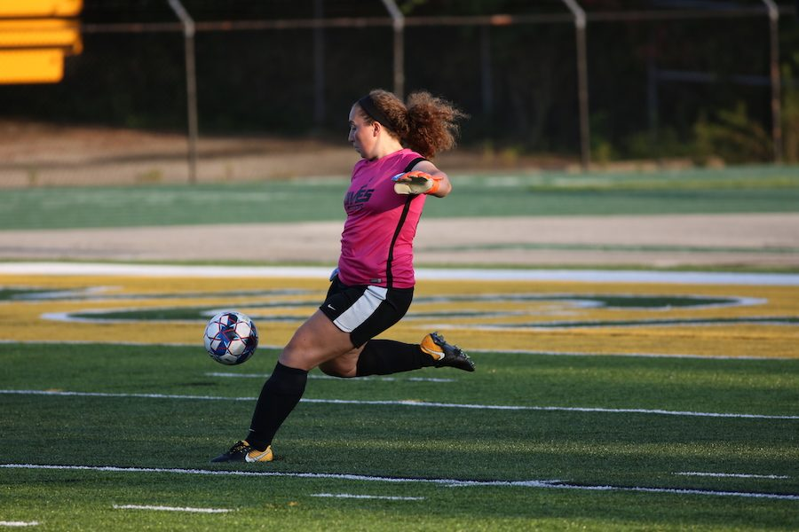 GOAL+KICK.+Senior+Mallory+Comerford%2C+goalie+of+the+girls+varsity+soccer+team%2C+powerfully+punts+the+ball+away+from+the+goal.+On+Aug.+30%2C+the+varsity+girls+soccer+team+played+their+positions+during+their+game%2C+which+ended+up+paying+off.+The+girls+worked+as+a+team+and+endured+the+hot+temperatures.
