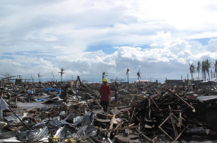 "DESTROYED. A man stands amidst the wreckage of 2013's Typhoon Haiyan in the city of Tacloban, Philippines. According to CNN, the super typhoon was a Category 5 storm that wreaked havoc across the Philippines and forced about 125,000 people nationwide to evacuate. ""We are prepared, but this is really a wallop,"" said Gov. Roger Mercado of a province called Southern Leyte, to CNN."