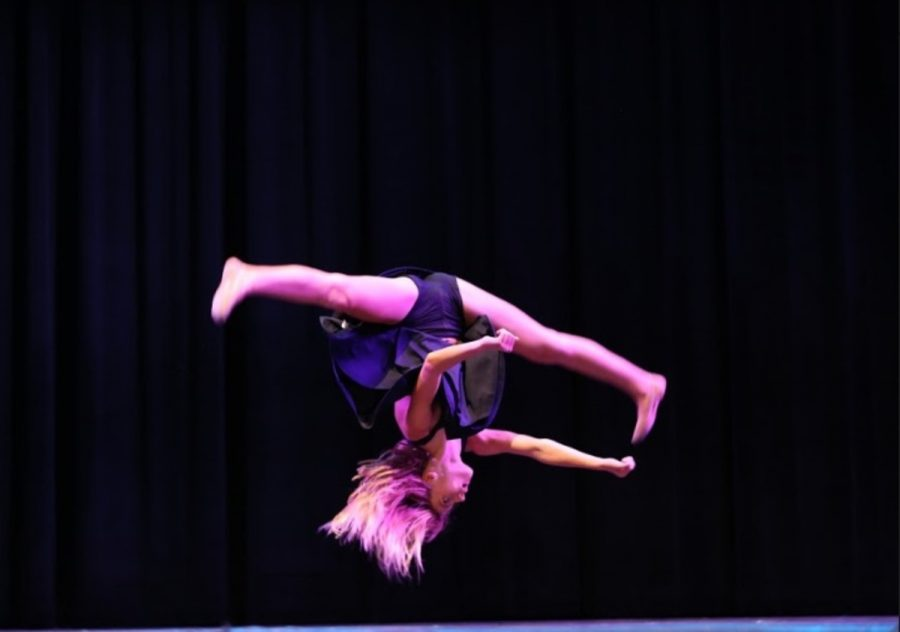 """DANCE THE NIGHT AWAY. A heart-stopping and jaw-dropping performance was brought by freshman Julia Mott at the Variety show. Mott delivered an eloquent statement about divorced families through her emotional dance routine, which she choreographed herself. She has been dancing since a very young age and has won many awards at the local, regional, state, and even national levels. """"What I love about dance is it gives me a chance to express myself. I also love it because the more I dance and teach [dance], I grow as a dancer,"""" Mott said."""