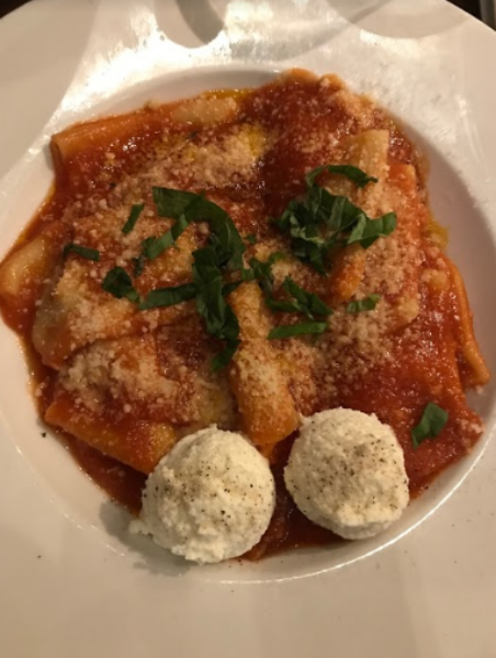 """DELICIOUS. The Paccheri is shown with an outstanding red sauce and topped with a coupe basil leaves with ricotta on the side. """"The Paccheri is devouring, it is full of flavor,"""" said Cy Khodadad, 9."""