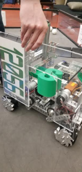 """Senior Ben Kleindorfer is an active member of the robotics team who competes in competitions with their robots. The team made the robot shown above most recently and used it to compete at state competition. """"This year, our team advanced to states and we're proud of our accomplishments,"""" Kleindorfer said."""
