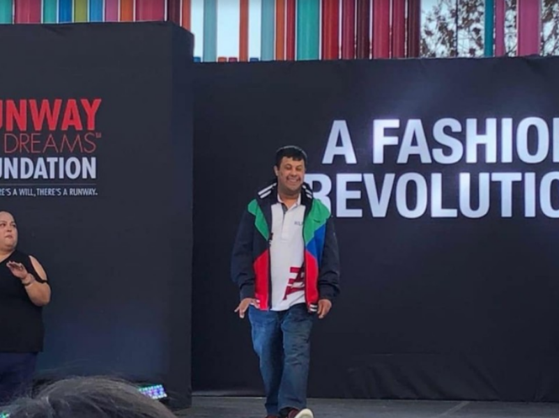 ROCKING THE RUNWAY. Vineet Narayan, a 2018 SHS graduate, walks down the runway at the Runway of Dreams Foundation (RODF) fashion show on March 27. RODF works to create mainstream adaptive clothing for people with disabilities. Narayan wore clothes made by Zappos Adaptive that had modifications that help people with disabilities dress themselves.