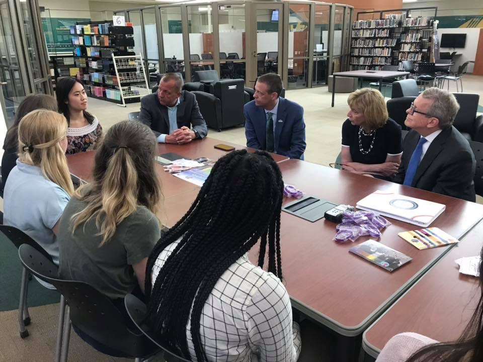 "LISTEN IN. Gov. Mike DeWine and First Lady Fran DeWine participate in a mental health roundtable discussion with SHS students, with Principal Doug Mader and Superintendent Frank Forsthoefel sitting in. Both the presentation of senior Madeline Hampson's scholarship and the roundtable were held in the Hub. ""It was a rectangular table, which was a little confusing,"" said Katie Good, 12, who participated in the discussion."