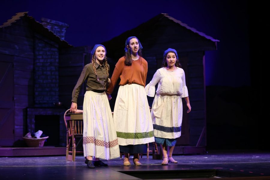 "MAKE ME A MATCH. Chava (freshman Peyton Hines), along with her sisters Tzeitel and Hodel (seniors Sydney Weiss and Shayna Kling) sing about what the future will bring for her in a scene from Aves Theatre's recent production of the hit musical, ""Fiddler on the Roof."" The show took place April 11-13 at Sycamore High School, and was a huge success both with the audience and financially. ""With this show, we were able to break the record for the amount of tickets sold for a one week show,"" said Aves Theatre director Mr. John Whapham"