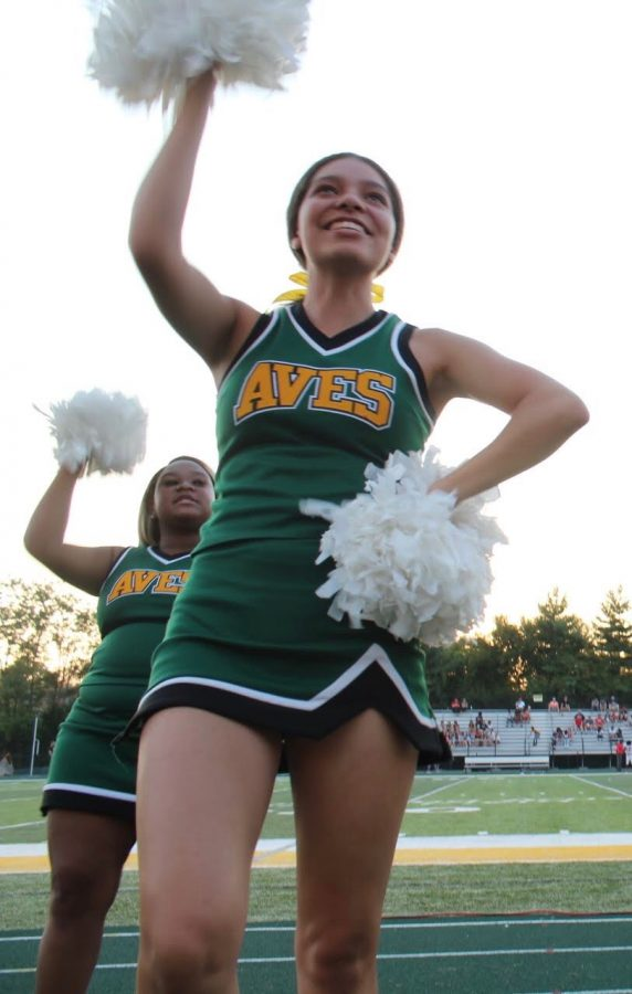 "GO AVES GO. Senior cheerleader Kennedy Archer is cheering on the Aves during one of their last home games. ""Stepping out on the track to cheer one last time was a decision I was happy I made. I stopped cheering when I got to high school, so I've missed the excitement of cheering. This has been an awesome season cheering with my teammates, one I will not forget,"" Archer said."