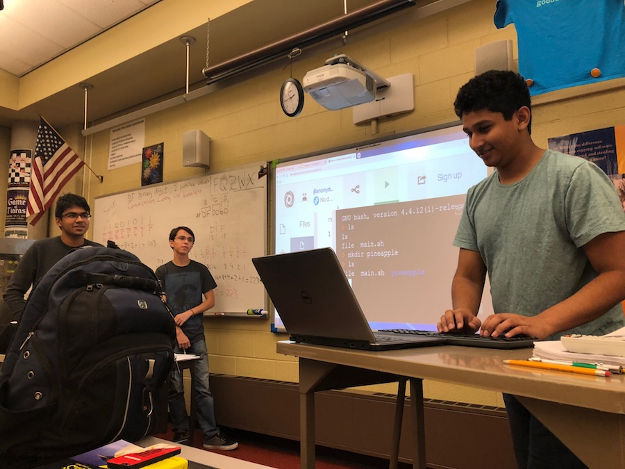 A DIFFERENT SYSTEM. Officer junior Krishna Suresh writes code in Linux to demonstrate how to create and search directories, which are like folders.