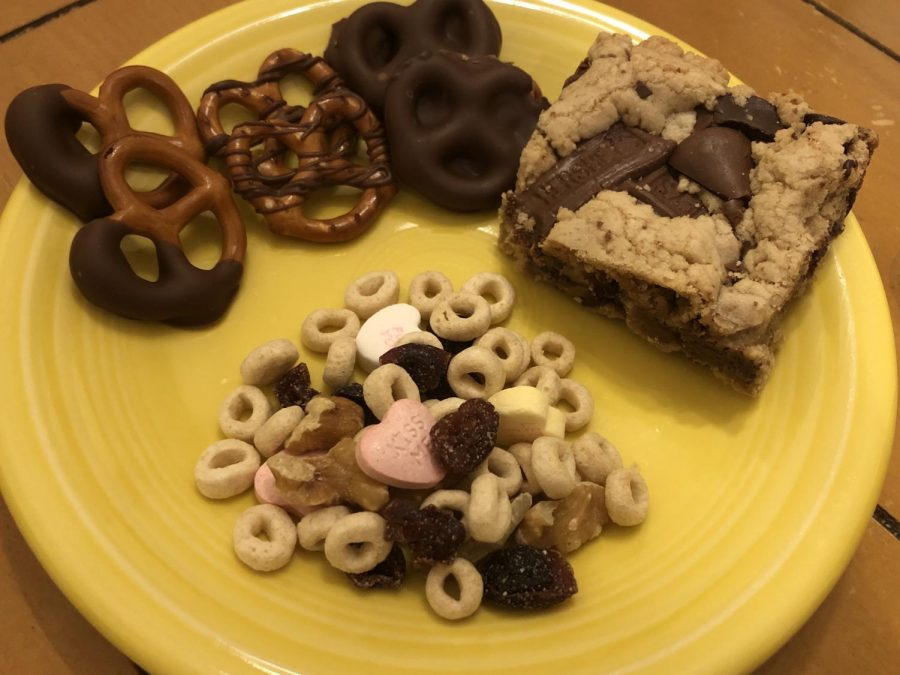 """ZERO WASTE. By using old candy to create something new, the issues of still having Valentine's Day candy several months later and wasting candy are things of the past. Next time you find yourself with an abundance of leftover candy, try these recipes on for size. From chocolate dipped pretzels, to candy-filled blondies, or a creative take on trail mix, everybody can find their perfect recipe. """"What I like about these recipes is that one can eat the candy in innovative and exciting ways, instead of the same old, straight from the wrapper candy bar,"""" said Ellen McPherson, 10."""