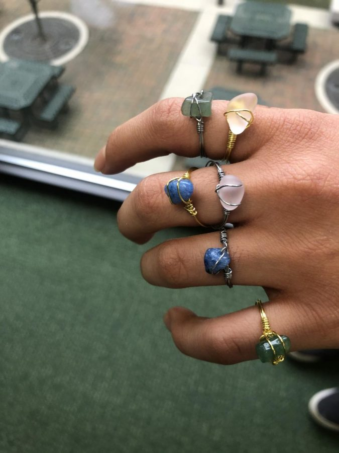 Hannah+Peri%2C+10%2C+is+hand+making+gemstone+rings+to+benefit+Dragonfly.+%E2%80%9CThe+rings+are+trendy+and+it%E2%80%99s+so+cool+to+see+people+buy+them+because+then+you+see+everyone+walking+around+school+with+the+rings+on%2C+and+it+shows+that+the+school+really+does+support+FFTC%E2%80%9D%2C+Peri+said.+